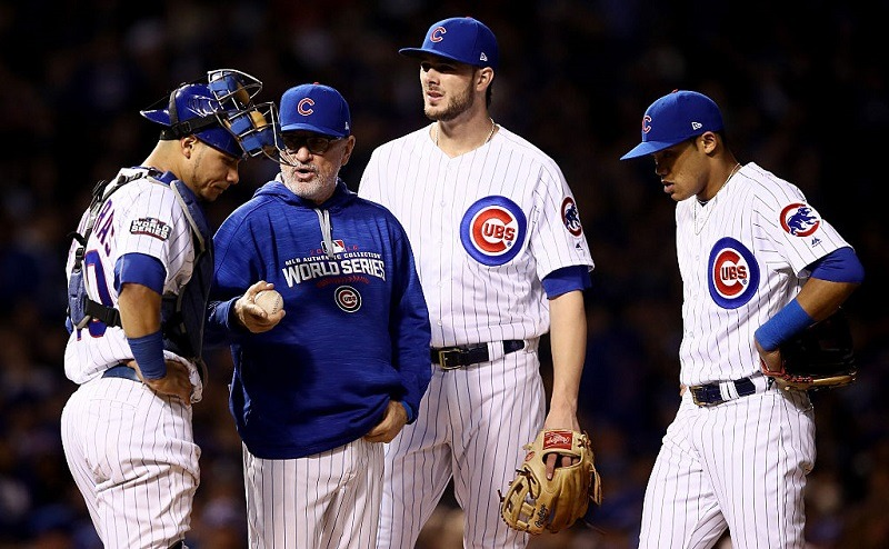 Joe Maddon stands on the mound, making pitching changes in Game 4 of the 2016 World Series.