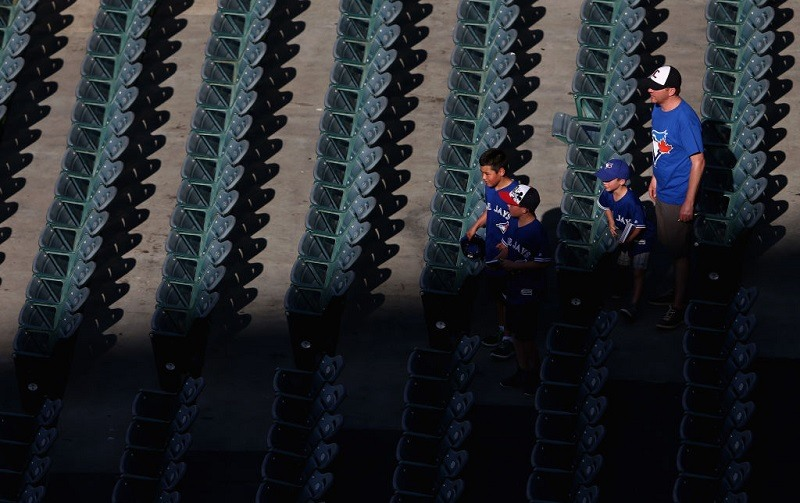 Fans walk to their seats during a game at Angel Stadium of Anaheim.