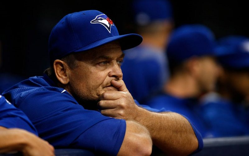 Manager John Gibbons #5 of the Toronto Blue Jays looks on from the dugout.