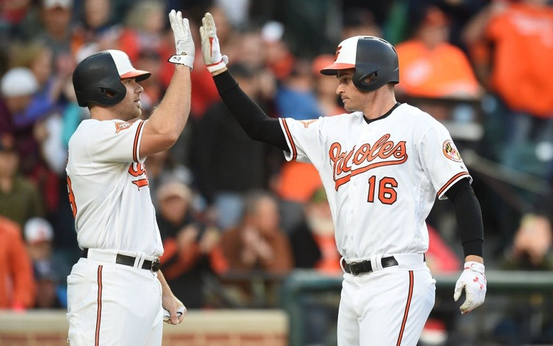 Trey Mancini #16 of the Baltimore Orioles celebrates his two-run homer with Chris Davis #19.