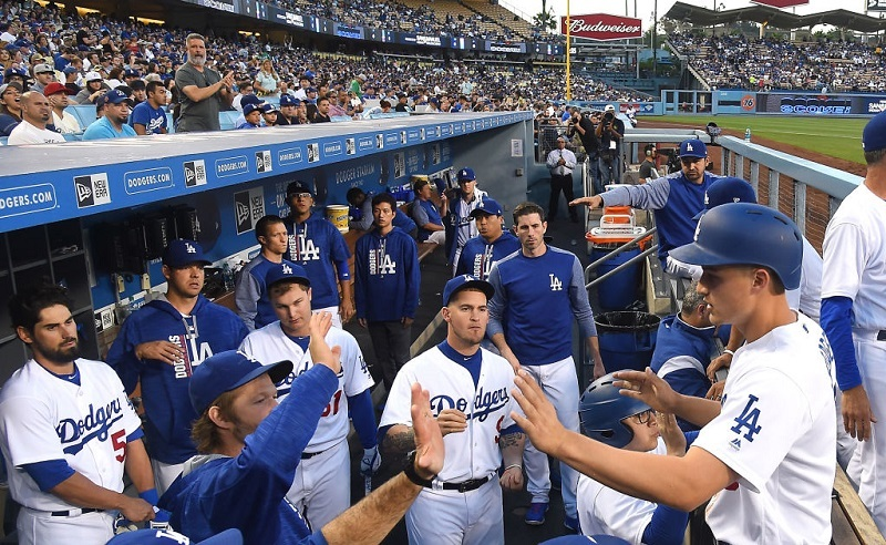 The Dodgers high-five during a break in the action at Dodger Stadium.