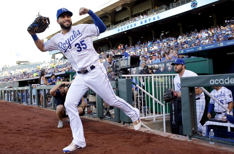 Eric Hosmer flexes his muscles during a game at Kauffman Stadium.