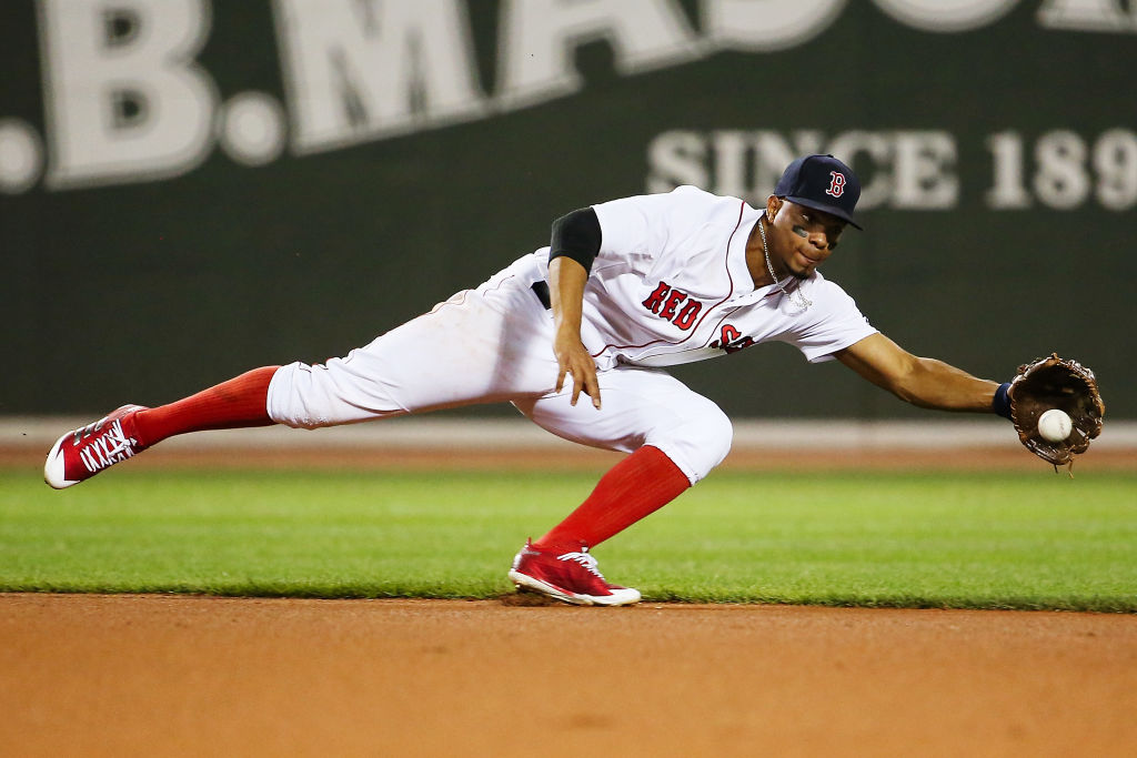 Xander Bogaerts dives for a ground ball.