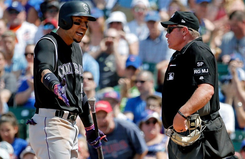 Carlos Gonzalez argues with an umpire at Wrigley Field.