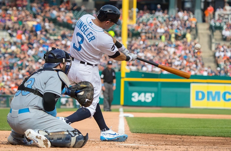 Ian Kinsler #3 of the Detroit Tigers hits an RBI double during a MLB game against the Tampa Bay Rays.