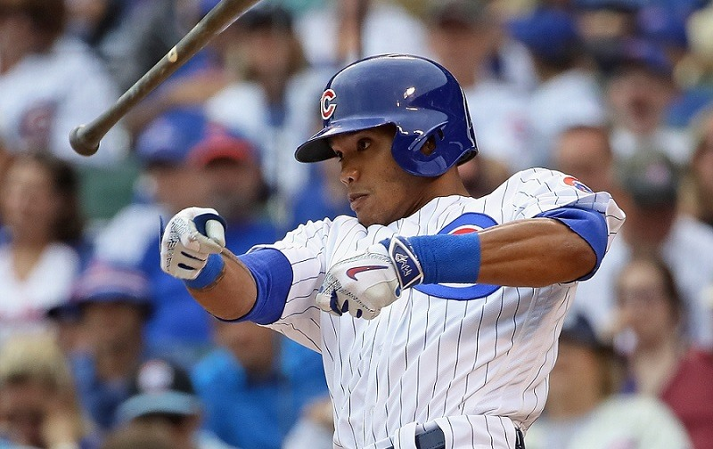 Addison Russell #27 of the Chicago Cubs loses his bat while hitting.