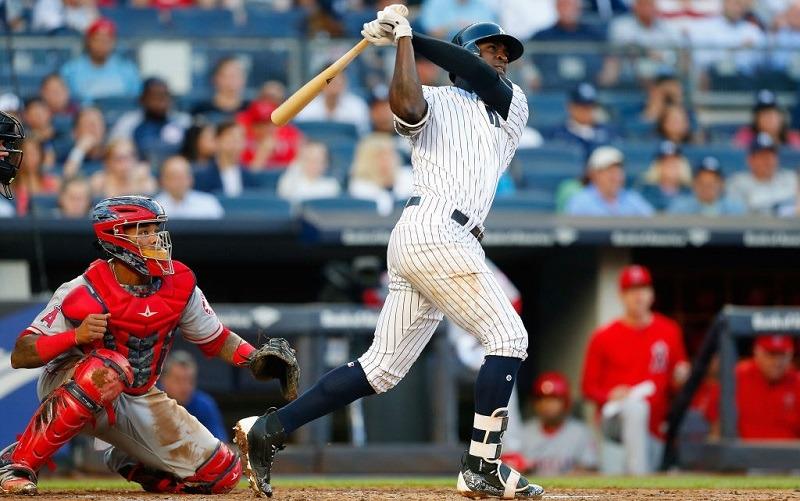 Didi Gregorius follows through on a home-run swing at Yankee Stadium.