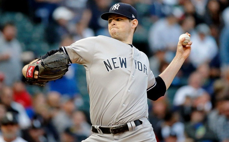 The Yankees' Jordan Montgomery pitches on the mound.
