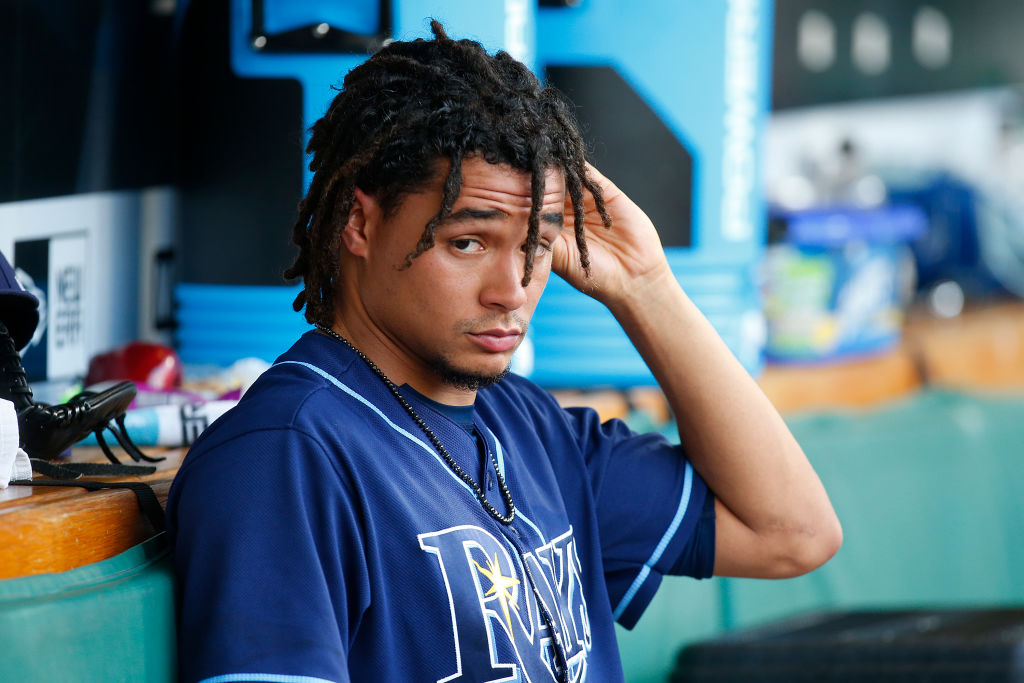 Chris Archer rests in the dugout.