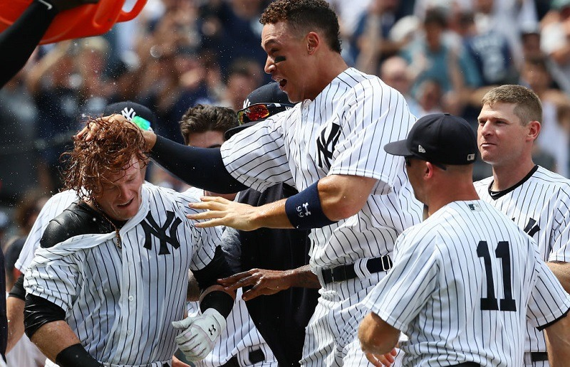 Aaron Judge celebrates with Clint Frazier and the Yankees after a win.