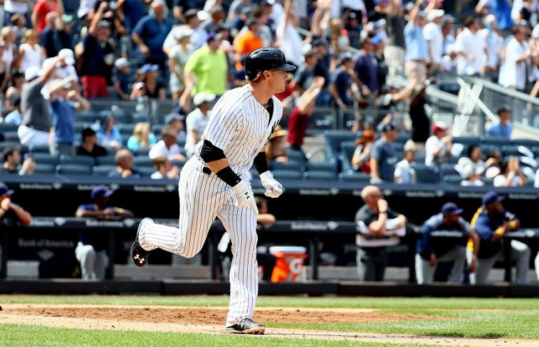 Clint Frazier watches his walk-off home run fly during a game at Yankee Stadium.