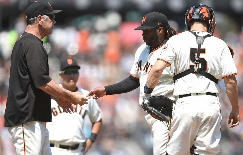 Bruce Bochy takes the ball from Johnny Cueto at AT&T Park in San Francisco.