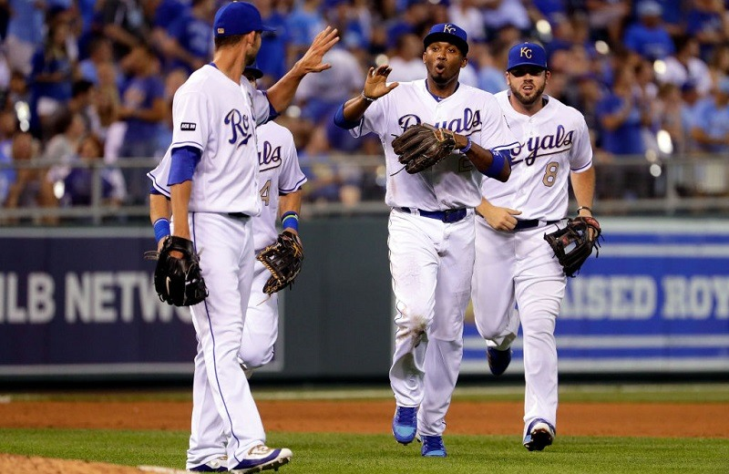 Alcides Escobar and Mike Minor celebrate during a game at Kauffman Stadium.