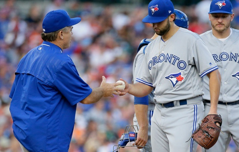 Mike Bolsinger #49 of the Toronto Blue Jays is pulled from the game by Manager John Gibbons.