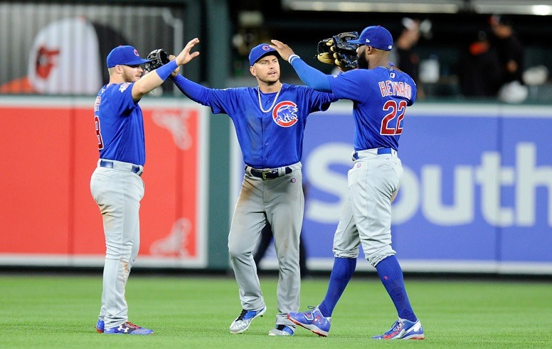 Cubs outfielders celebrate after a win in Baltimore.