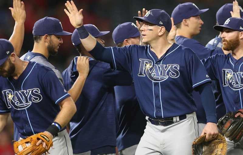 The Tampa Bay Rays celebrate at Angel Stadium of Anaheim.