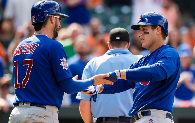 Anthony Rizzo #44 of the Chicago Cubs celebrates with teammate Kris Bryant #17 after hitting a two-run home run.