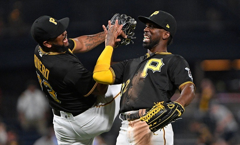 Felipe Rivero #73 of the Pittsburgh Pirates celebrates with Andrew McCutchen #22 after the final out in the Pittsburgh Pirates' 4-2 win over the Milwaukee Brewers on July 17.