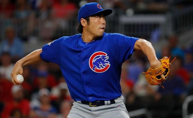 Koji Uehara represents the Cubs on the mound.