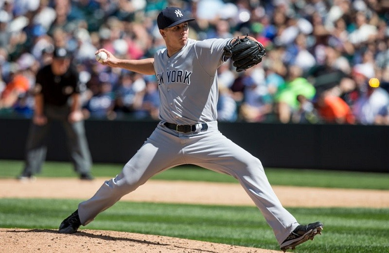 Reliever Chad Green #57 of the New York Yankees delivers during a game.
