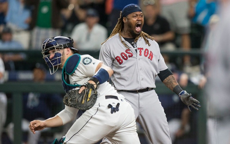 Hanley Ramirez #13 of the Boston Red Sox celebrates scoring a run on a single by Sandy Leon.