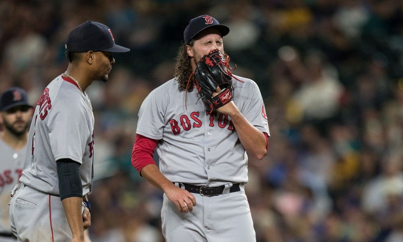 Relief pitcher Heath Hembree #37 of the Boston Red Sox reacts before getting pulled from a game.