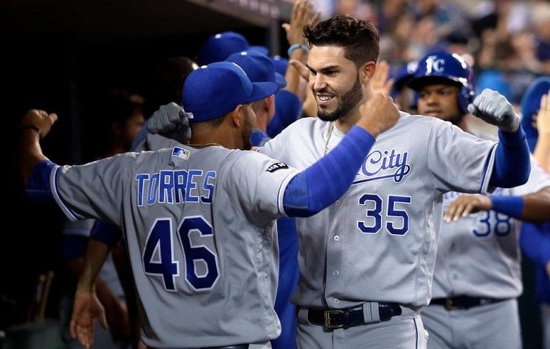 Eric Hosmer #35 of the Kansas City Royals celebrates with Ramon Torres #46 after hitting a grand slam.