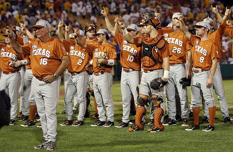 The Texas Longhorns celebrate a win with fans during the 2009 NCAA College World Series.