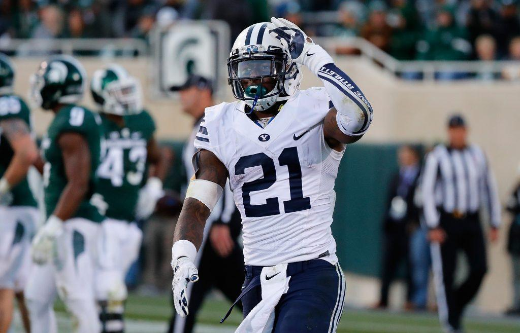 Jamaal Williams #21 of the Brigham Young Cougars celebrates a win.
