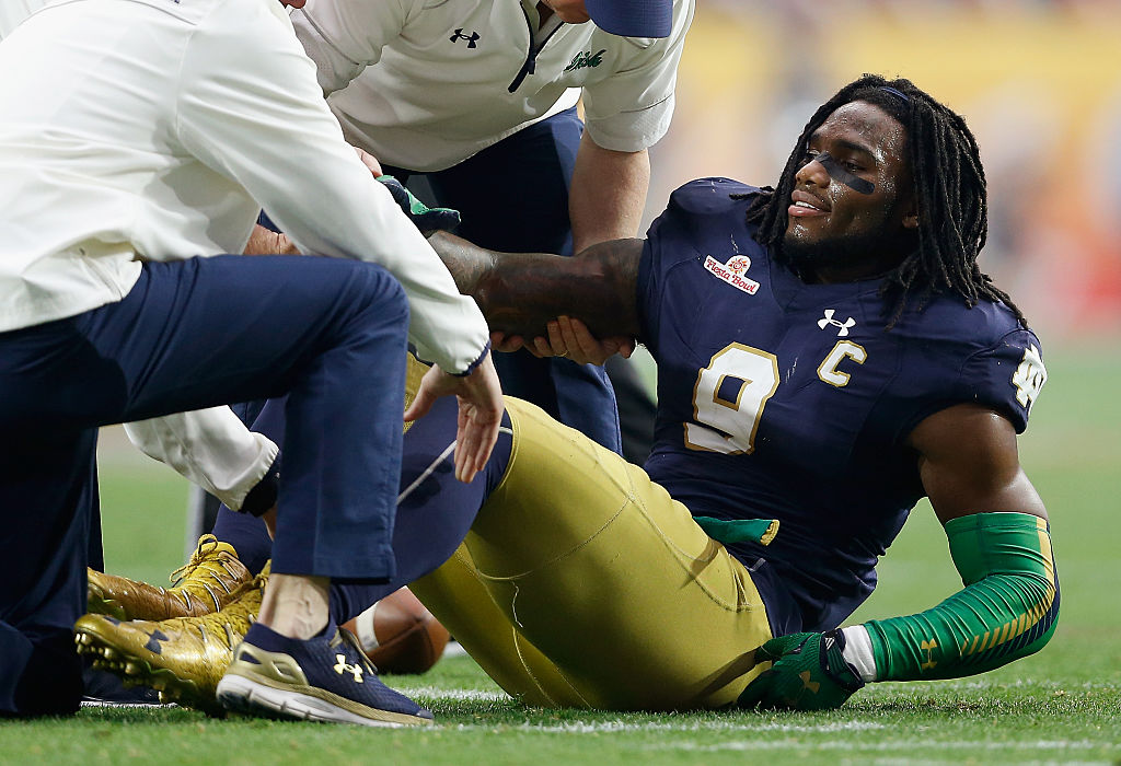 Jaylon Smith of the Notre Dame Fighting Irish lays on the field after an injury during the BattleFrog Fiesta Bowl.