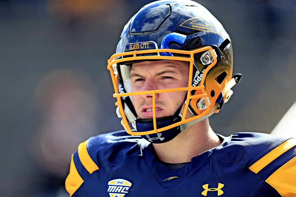 Toledo Rockets quarterback Logan Woodside stands on the sidelines against the Central Michigan Chippewas.