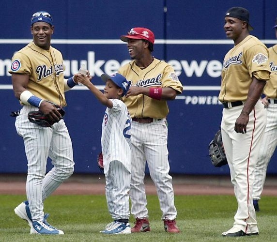 Sammy Sosa, Jimmy Rollins, and Barry Bonds look on during battle practice.