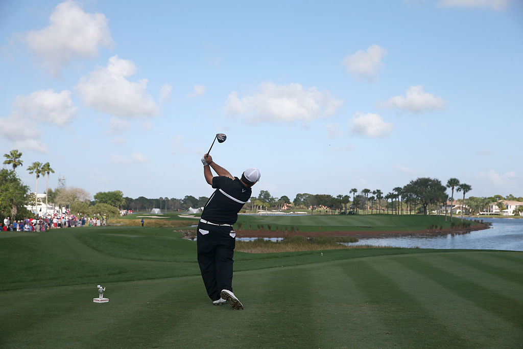 A golf pro plays at PGA National Resort & Spa - Champion Course in Palm Beach Gardens, Florida.