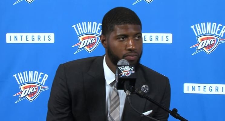 Paul George addresses the media during an OKC conference.
