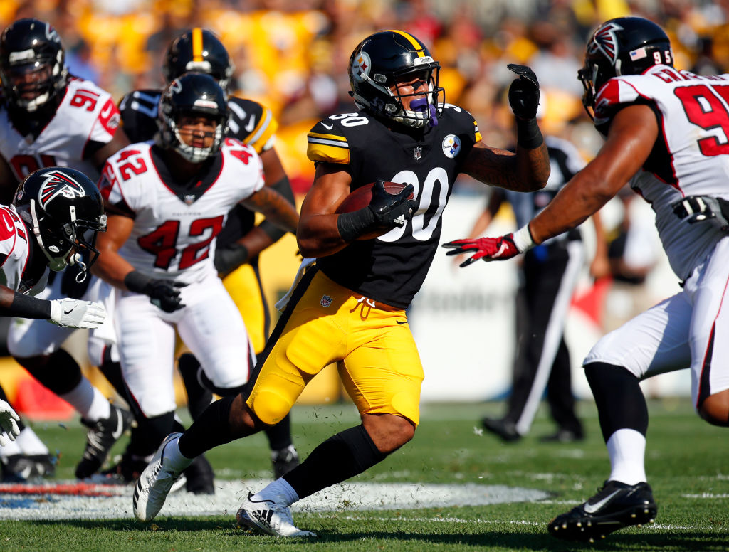 James Conner #30 of the Pittsburgh Steelers rushes against the Atlanta Falcons