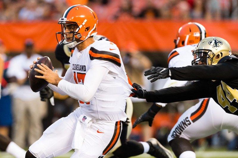 Quarterback Brock Osweiler #17 of the Cleveland Browns narrowly escapes outside linebacker Hau'oli Kikaha.