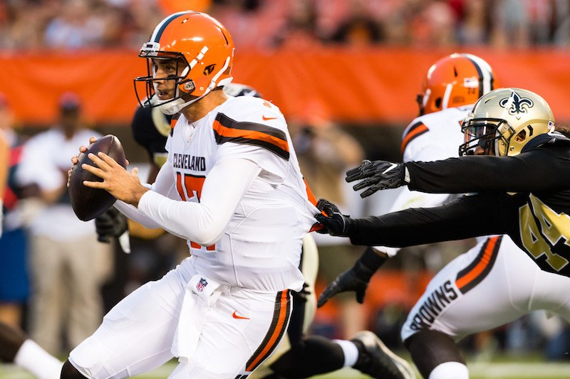 Quarterback Brock Osweiler #17 of the Cleveland Browns narrowly escapes outside linebacker Hau'oli Kikaha.