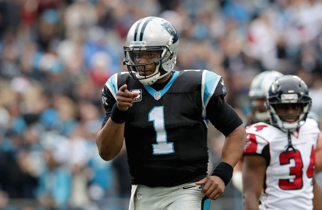 Cam Newton reacts to a touchdown throw.