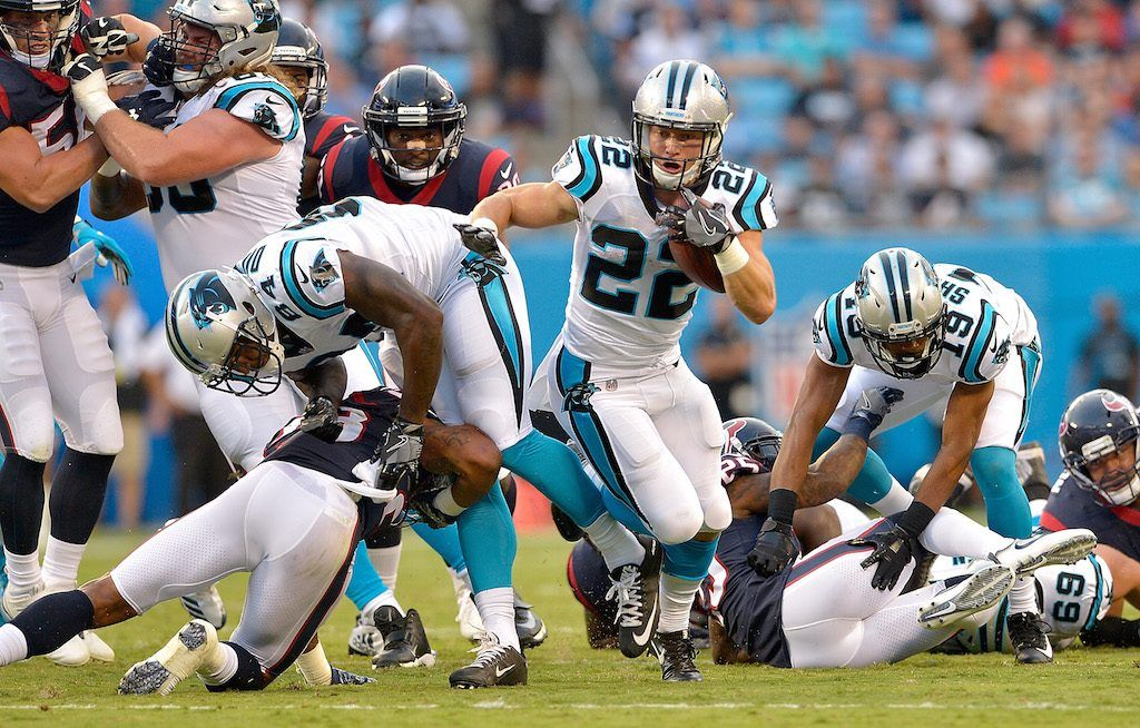 CHARLOTTE, NC - AUGUST 09: Christian McCaffrey #22 of the Carolina Panthers runs against the Houston Texans during the preseason game at Bank of America Stadium on August 9, 2017 in Charlotte, North Carolina. (Photo by Grant Halverson/Getty Images)