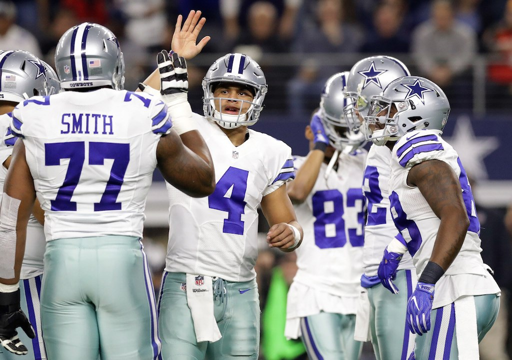 Dak Prescott celebrates with his teammates in the huddle.