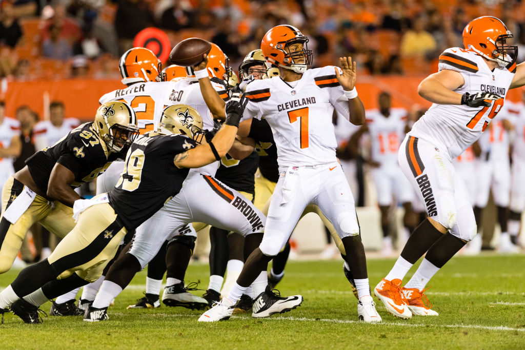 Quarterback DeShone Kizer of the Cleveland Browns passes while under pressure from New Orleans Saints linebacker Adam Bighill.