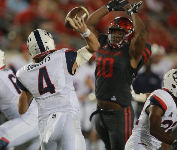 Ed Oliver #10 looks to block a pass.