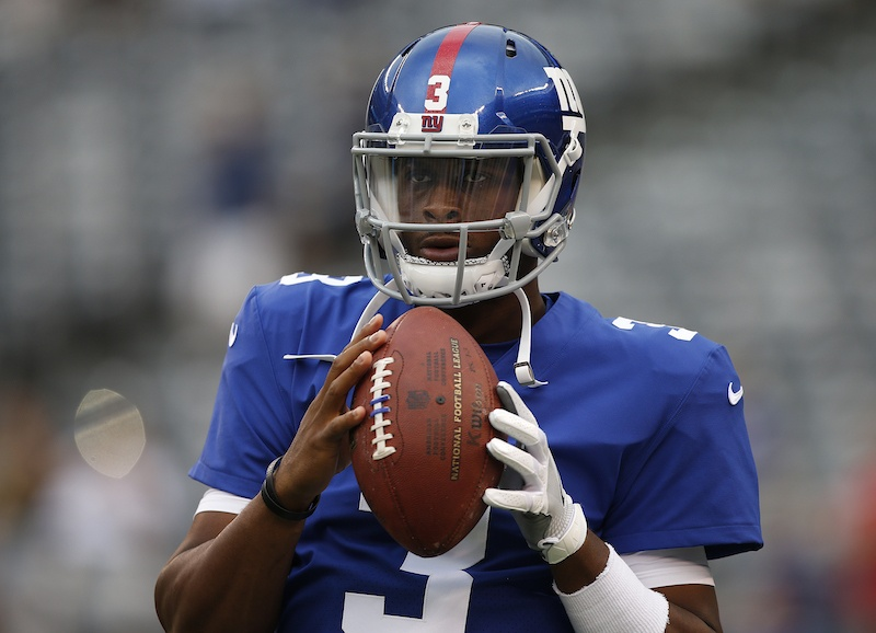 Geno Smith #3 of the New York Giants warms up before an NFL preseason game.