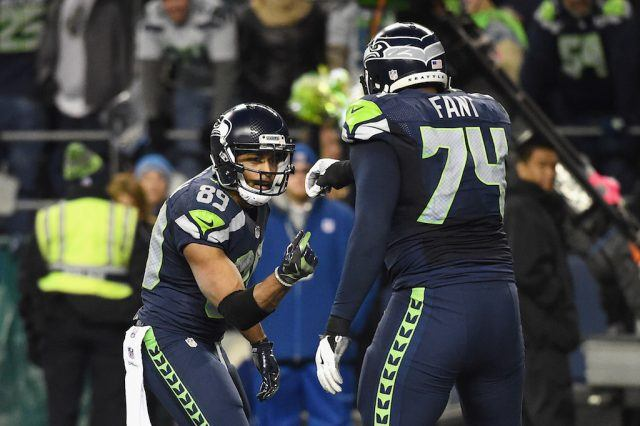 Doug Baldwin (L) and George Fant celebrate a touchdown.