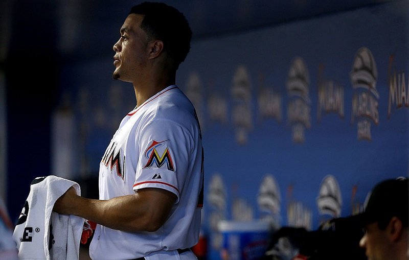 Giancarlo Stanton in the Marlins dugout in 2013