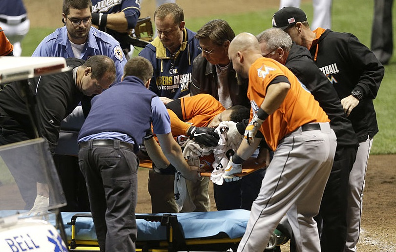 Giancarlo Stanton #27 of the Miami Marlins is lifted onto a stretcher after getting hit by a pitch from Mike Fiers of the Milwaukee Brewers during the top of the fifth inning at Miller Park on September 11, 2014 in Milwaukee, Wisconsin.