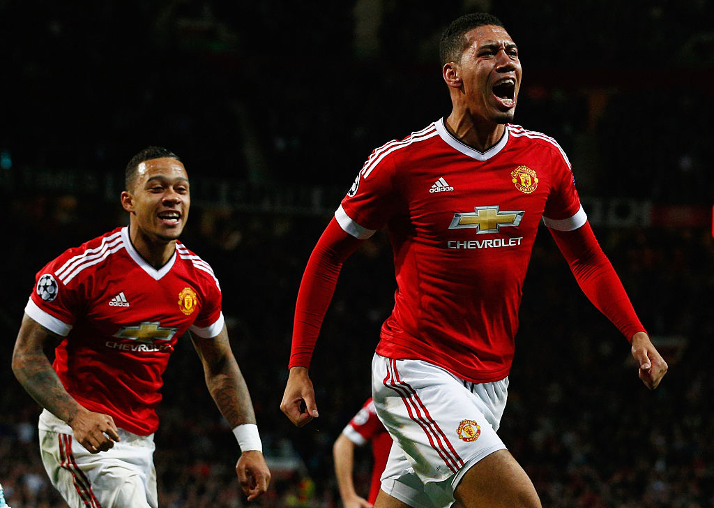 Chris Smalling of Manchester United celebrates with teammate Memphis Depay as he scores their second goal.