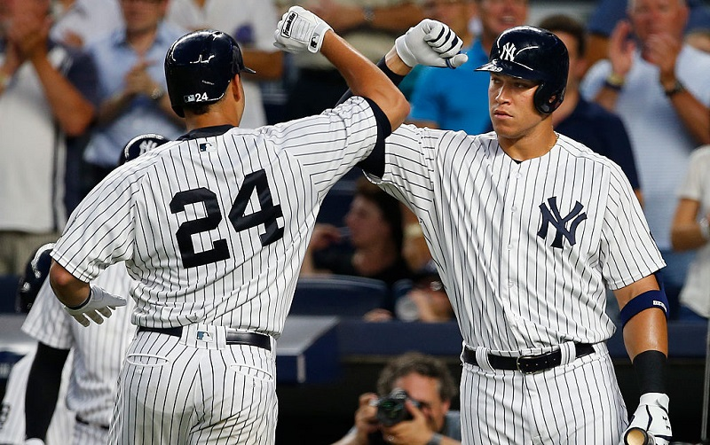 NEW YORK, NY - AUGUST 16: Gary Sanchez #24 of the New York Yankees is congratulated by Aaron Judge #99 after he hit a home run against the Toronto Blue Jays during the second inning of a game at Yankee Stadium on August 16, 2016 in the Bronx borough of New York City.