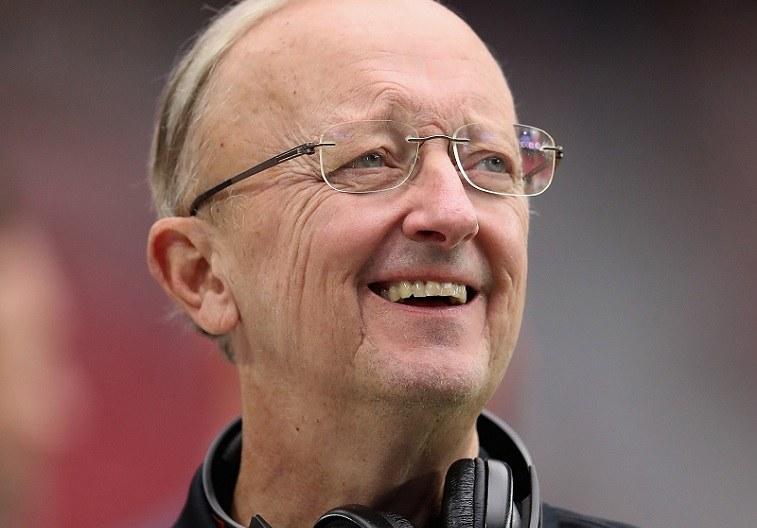 Former NFL insider John Clayton smiles