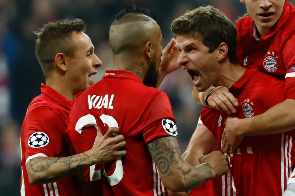 Bayern Munich's forward Thomas Mueller celebrate scoring a goal with his teammates.